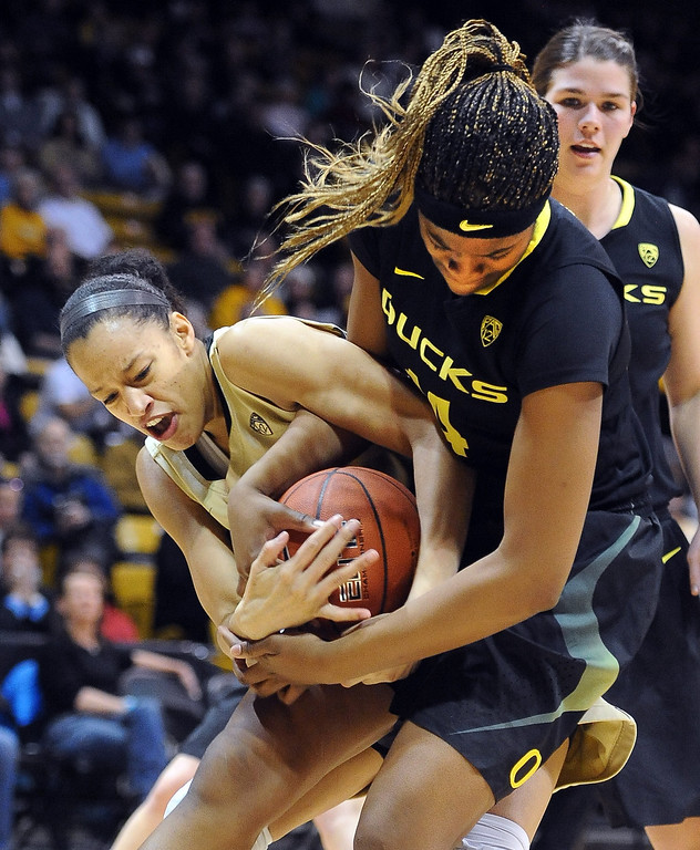 . Arielle Roberson of CU and Jillian Alleyne of Oregon, try to get possession. Cliff Grassmick / February 10, 2013