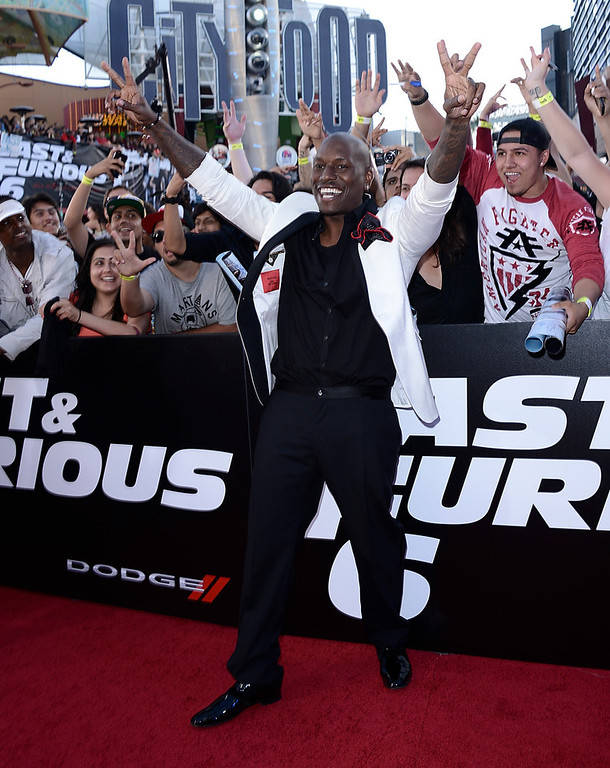 """. Actor and singer Tyrese Gibson arrives at the LA Premiere of the \""""Fast & Furious 6\"""" at the Gibson Amphitheatre on Tuesday, May 21, 2013 in Universal City, Calif. (Photo by Dan Steinberg/Invision/AP)"""