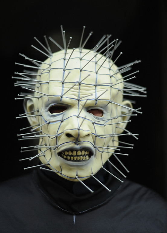 . WHITBY, ENGLAND - NOVEMBER 02: Alan Marton, a drayman from Middlesbrough, dresses as the horror character \'Pinhead\' as he visits the Goth weekend on November 2, 2013 in Whitby, England. The Whitby Gothic Weekend that takes place in the Yorkshire seaside town twice yearly in Spring and Autumn started in 1994 and sees thousands of extravagantly dressed followers of Victoriana, Steampunk, Cybergoth and Romanticism visit to take part in celebrating Gothic culture.  (Photo by Ian Forsyth/Getty Images)