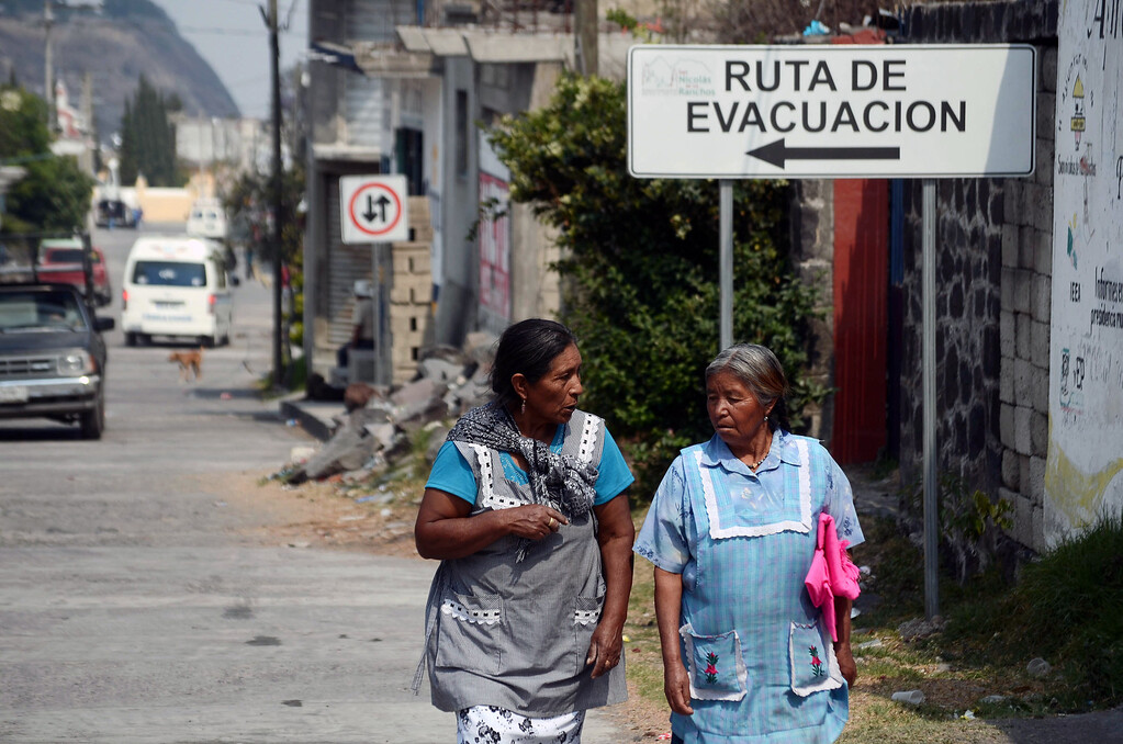 . Two women walk in San Nicolas de los Ranchos community near Popocatepetl volcano, in Puebla, Mexico, on May 12, 2013. According to a report by the National Center of Prevention of Disasters (CENAPRED) the yellow alert phase three is still in force.  Jose Castañares/AFP/Getty Images