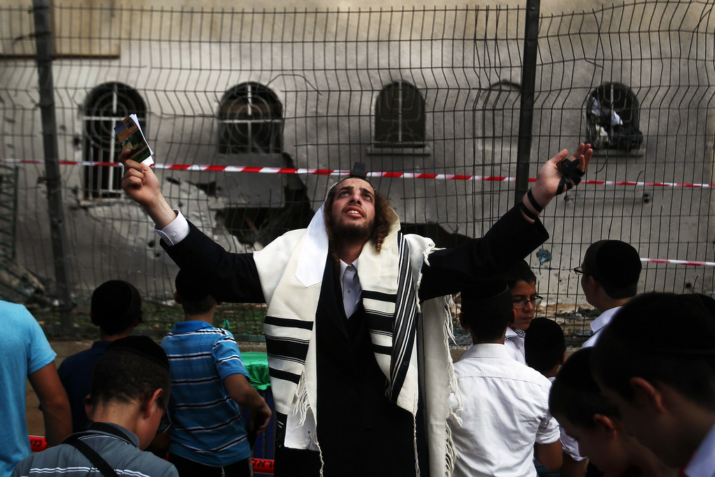 . An Ultra-Orthodox Jewish man prays in front of a synagogue after it was hit by a rocket launched from the Gaza Strip, on August 22, 2014, in the southern costal Israeli city of Ashdod. Israeli Prime Minister Benjamin Netanyahu vowed harsh retribution against Hamas, the Islamist rulers of Gaza, after a mortar round fired from the Palestinian territory killed an Israeli child. DAVID BUIMOVITCH/AFP/Getty Images