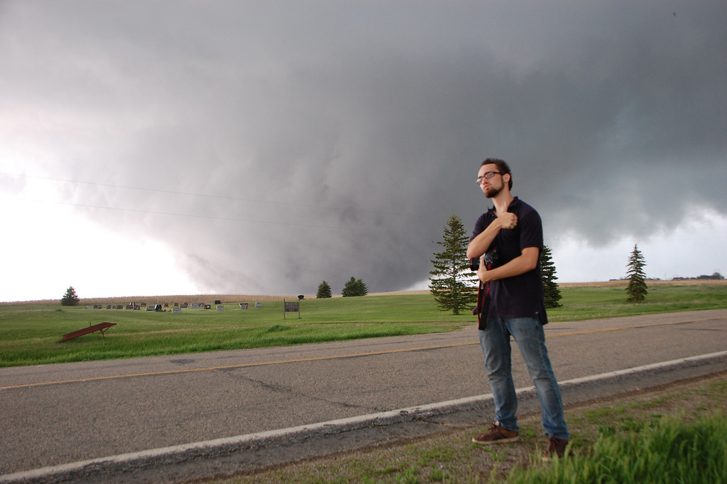 . Paul Samaras stands near an approaching tornado while storm chasing near Bowdle, South Dakota on May 22, 2010. (Photo by Ed Grubb)