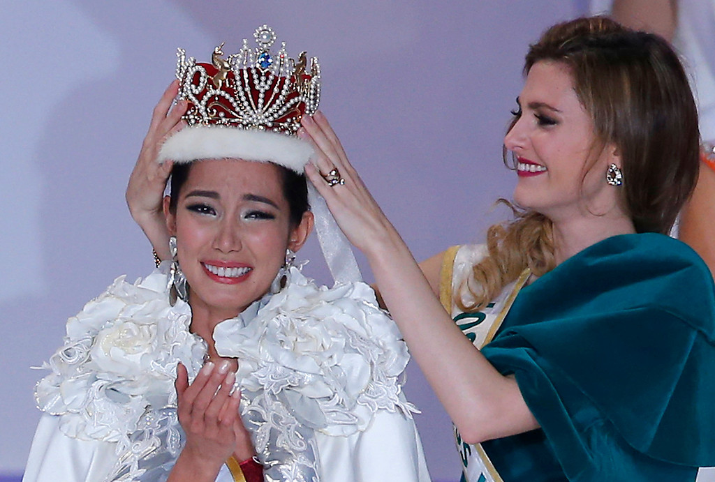 . Newly-crowned Miss International Bea Rose Santiago of Philippines, left, is congratulated by former Miss International 2008 Alejandra Andreu of Spain during the final of the Miss International 2013 Beauty Pageant in Tokyo Tuesday, Dec. 17, 2013. (AP Photo/Shizuo Kambayashi)
