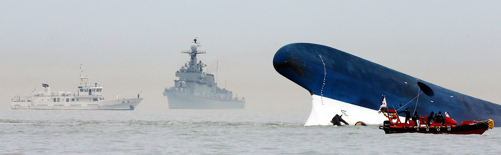 . Divers search the Sewol, a 6,825-ton passenger ship owned by Chonghaejin Marine Co., 20 kilometers off of Jindo, South Korea, on Wednesday, April 16, 2014. South Korea\'s government said 293 people are missing after a ferry carrying hundreds of high school students sank en route to the resort island of Jeju. At least two people, including a student, died in the accident. Source: Yonhap News via Bloomberg EDITOR\'S NOTE: NO SALES. EDITORIAL USE ONLY.