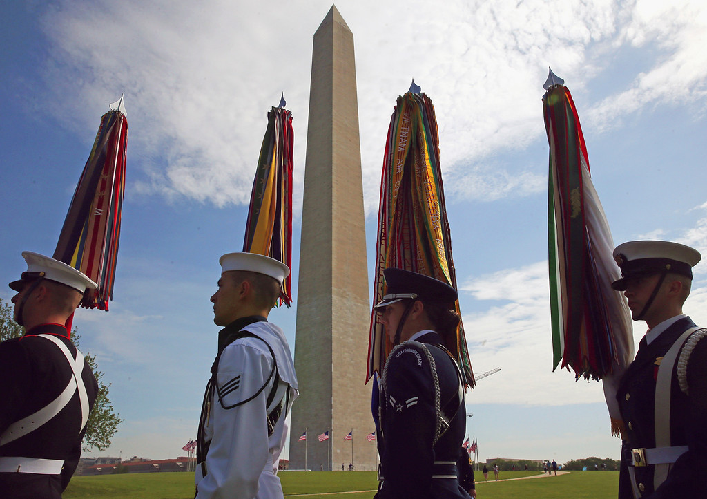 . A Military Honor Guard participates in the reopening ceremony at the Washington Monument,  May 12, 2014  Washington, DC. The Washington Monument was reopened after it has been closed for a restoration due to damage caused by a 5.8-magnitude earthquake that struck the Washington, DC, area on August 23, 2011. (Photo by Mark Wilson/Getty Images)