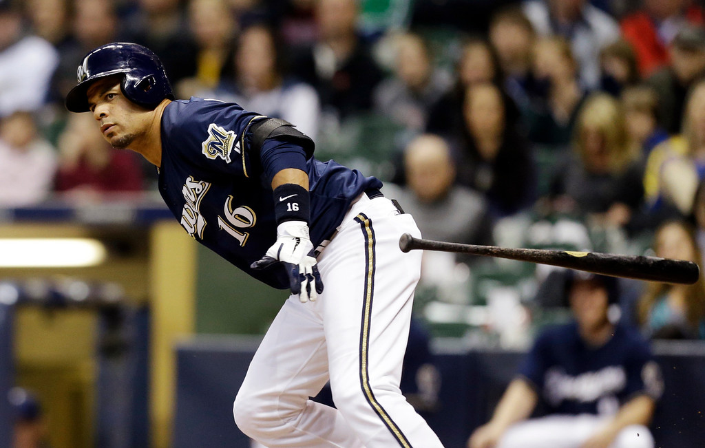 . Milwaukee Brewers\' Aramis Ramirez watches his double against the Colorado Rockies during the third inning of a baseball game, Wednesday, April 3, 2013, in Milwaukee. (AP Photo/Jeffrey Phelps)