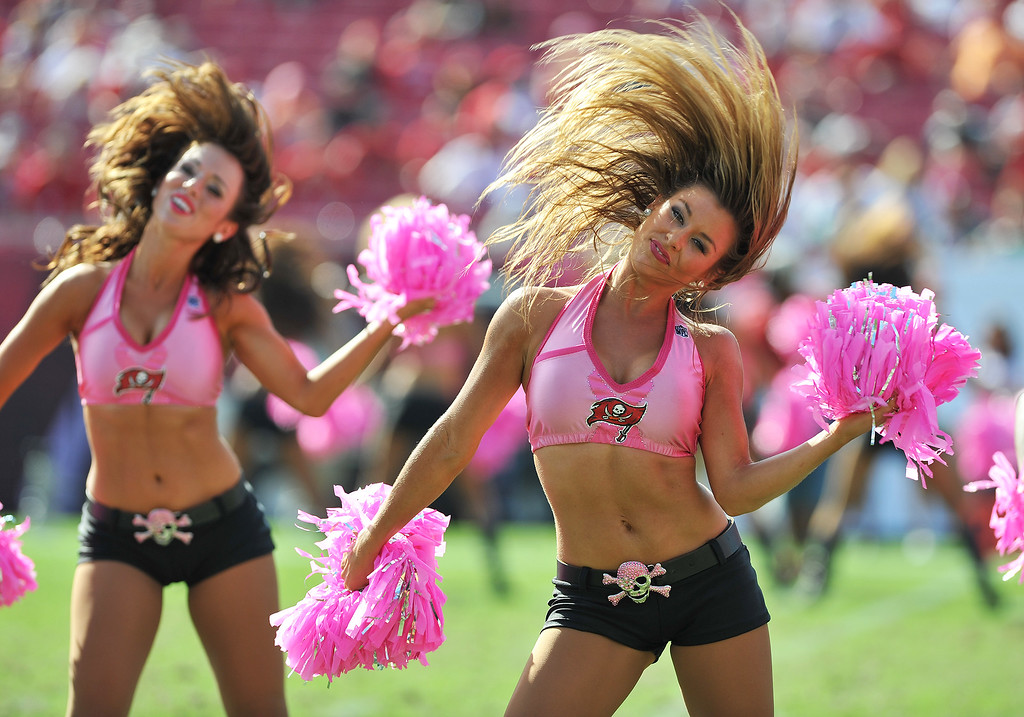 . TAMPA, FL - OCTOBER 13: Cheerleaders of the Tampa Bay Buccaneers dance at the two-minute warning against the Philadelphia Eagles October 13, 2013 at Raymond James Stadium in Tampa, Florida. The Eagles won 31 - 20. (Photo by Al Messerschmidt/Getty Images)