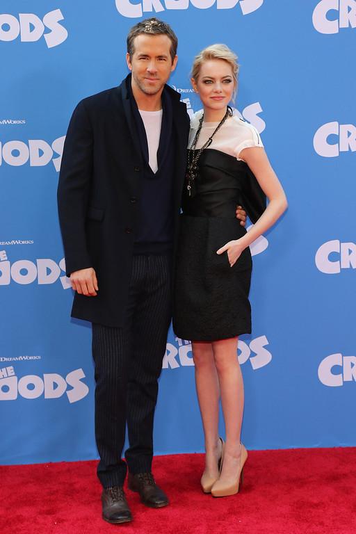 """. Actors Ryan Reynolds (L) and Emma Stone attend \""""The Croods\"""" premiere at AMC Loews Lincoln Square 13 theater on March 10, 2013 in New York City.  (Photo by Neilson Barnard/Getty Images)"""