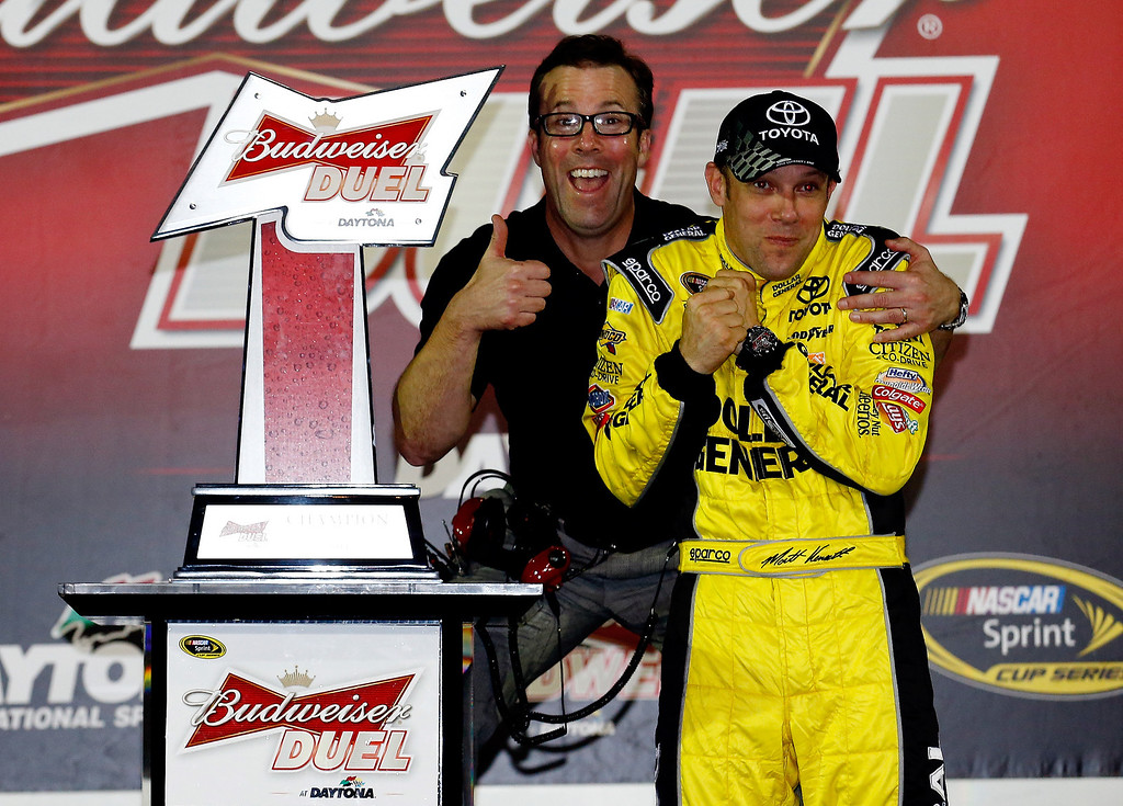 . Matt Kenseth, driver of the #20 Dollar General Toyota, celebrates in Victory Lane with president of Joe Gibbs Racing J. D. Gibbs after winning the NASCAR Sprint Cup Series Budweiser Duel 1 at Daytona International Speedway on February 20, 2014 in Daytona Beach, Florida.  (Photo by Tom Pennington/Getty Images)