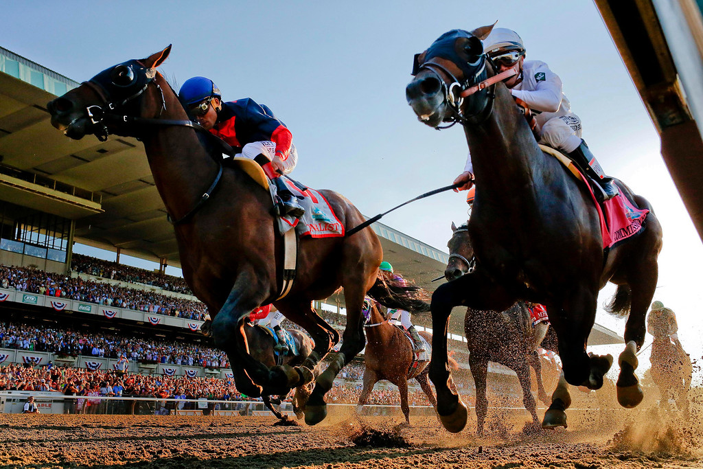 . Tonalist, left, with Joel Rosario up edges out Commissioner with Javier Castellano up to win the 146th running of the Belmont Stakes horse race, Saturday, June 7, 2014, in Elmont, N.Y. (AP Photo/Matt Slocum)