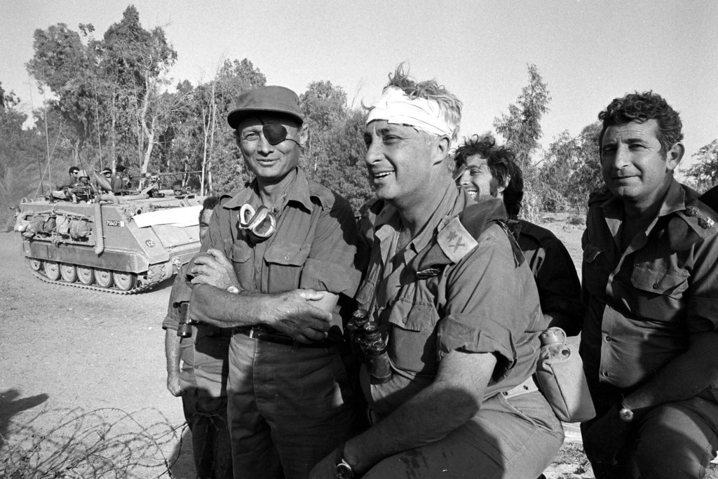 . SUEZ CANAL, EGYPT - OCTOBER 1973: Israeli army Southern Command General Ariel Sharon with Defense Minister Moshe Dayan during the Yom Kippur War in October 1973 on the western bank of the Suez Canal in Egypt. (Photo by Ministry of Defense via Getty Images)