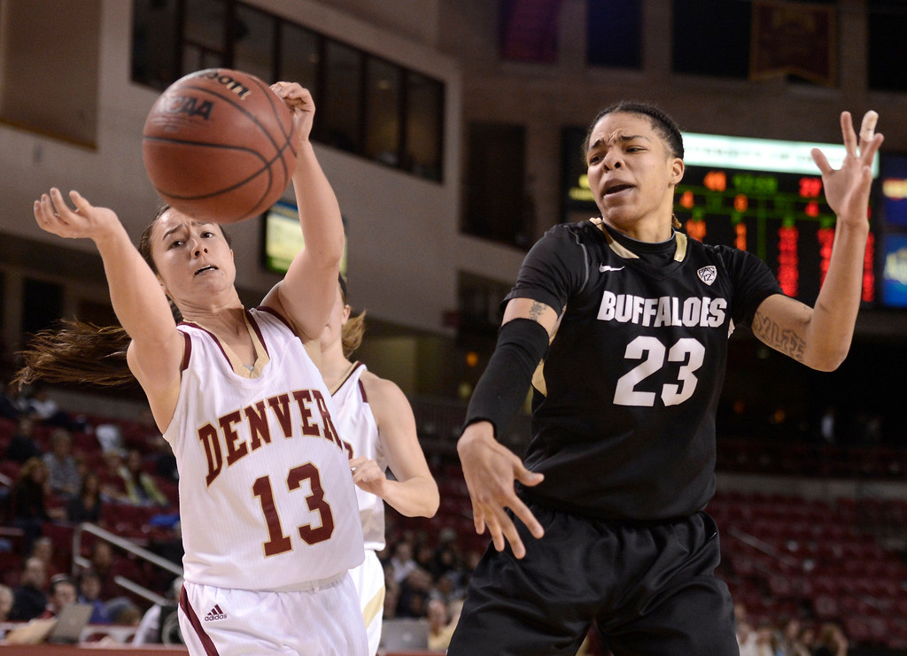 . University of Colorado\'s Chucky Jeffery fights for a loose ball with Emiko Smith during a games against the University of Denver on Tuesday, Dec. 11, at the Magnus Arena on the DU campus in Denver.   (Jeremy Papasso/Daily Camera)