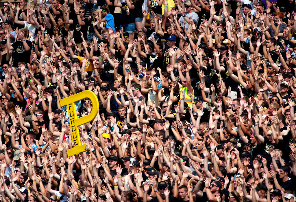 . The Purdue student section cheers against Indiana State during the second half of an NCAA college football game at Ross-Ade Stadium, in West Lafayette, on Saturday, Sept. 7, 2013. (AP Photo/Journal & Courier, Brent Drinkut)