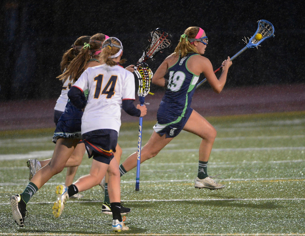 . LITTLETON, CO - MAY 8: Brianna LeCompte, right, ThunderRidge High School, heads down field against Heritage/Littleton during the second half of play at Littleton Public Schools Stadium during the first round of the 2013 Colorado Girls State Lacrosse Championships May 8, 2013. ThunderRidge won 8-5. (Photo By Andy Cross/The Denver Post)