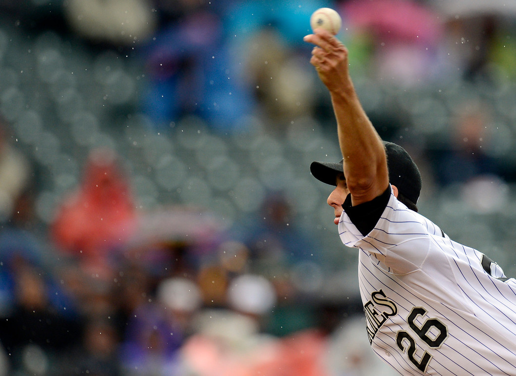. Jeff Francis (26) of the Colorado Rockies delivers a pitch against the New York Yankees during the first inning May 9, 2013 at Coors Field. (Photo By John Leyba/The Denver Post)