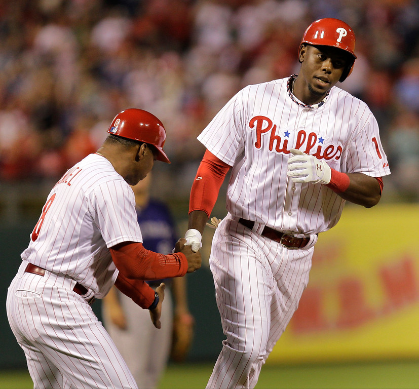 . Philadelphia Phillies\' John Mayberry funds the bases after hitting a home run in the fourth of a baseball game against the Colorado Rockies, Monday, Aug. 19, 2013, in Philadelphia. (AP Photo/Laurence Kesterson)
