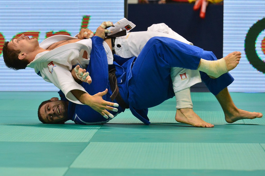 . Georgia\'s Varlam Liparteliani (white) and Russia\'s Kirill Denisov compete in a men\'s -90kg category semifinal, during the IJF World Judo Championship, in Rio de Janeiro, Brazil, on August 30, 2013.  YASUYOSHI CHIBA/AFP/Getty Images