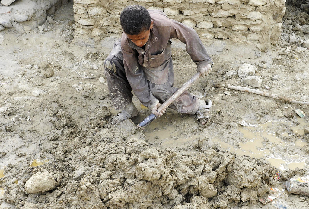 . A Pakistani earthquake survivor mixes mud to rebuild his house in the devastated district of Awaran on September 25, 2013. A powerful 6.8-magnitude earthquake hit southwest Pakistan, in a region already devastated by a tremor which left more than 300 people dead and 100,000 homeless less than a week ago.  BANARAS KHAN/AFP/Getty Images