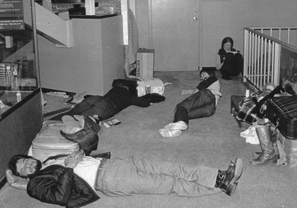 . Air Travelers sleep at Stapleton International Airport Christmas night 12/25 as they wait for their flights. Officials managed to open one runway late 12/25. Thousands were stranded by the Blizzard of 1982. Credit: UPI