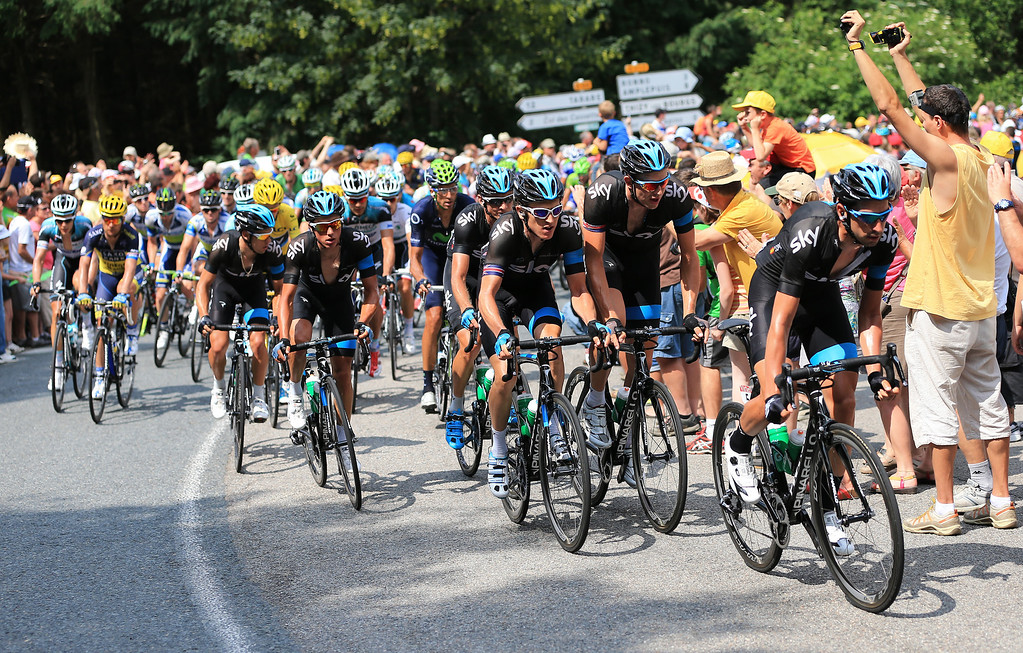 . LYON, FRANCE - JULY 13: Team SKY Procycling set the pace in the chasing group led by David Lopez (R) of Spain and SKY Procycling during stage fourteen of the 2013 Tour de France, a 191KM road stage from Saint-Pourcain-sur-Sioule to Lyon, on July 13, 2013 in Lyon, France.  (Photo by Doug Pensinger/Getty Images)