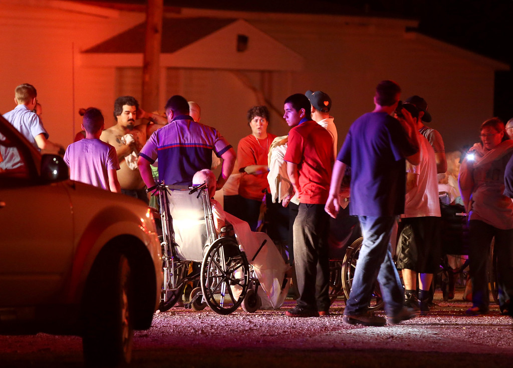 . Elderly persons from a nearby nursing home are triaged in a parking lot before being moved to a school stadium following a fertilizer plant explosion Wednesday, April 17, 2013, in West, Texas. The explosion near Waco Wednesday night injured dozens of people and sent flames shooting high into the night sky, leaving the factory a smoldering ruin and causing major damage to surrounding buildings. (AP Photo/Waco Tribune Herald, Rod Aydelotte)