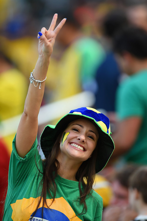 . A fan cheers during the 2014 FIFA World Cup Brazil Group F match between Iran and Nigeria at Arena da Baixada on June 16, 2014 in Curitiba, Brazil.  (Photo by Matthias Hangst/Getty Images)
