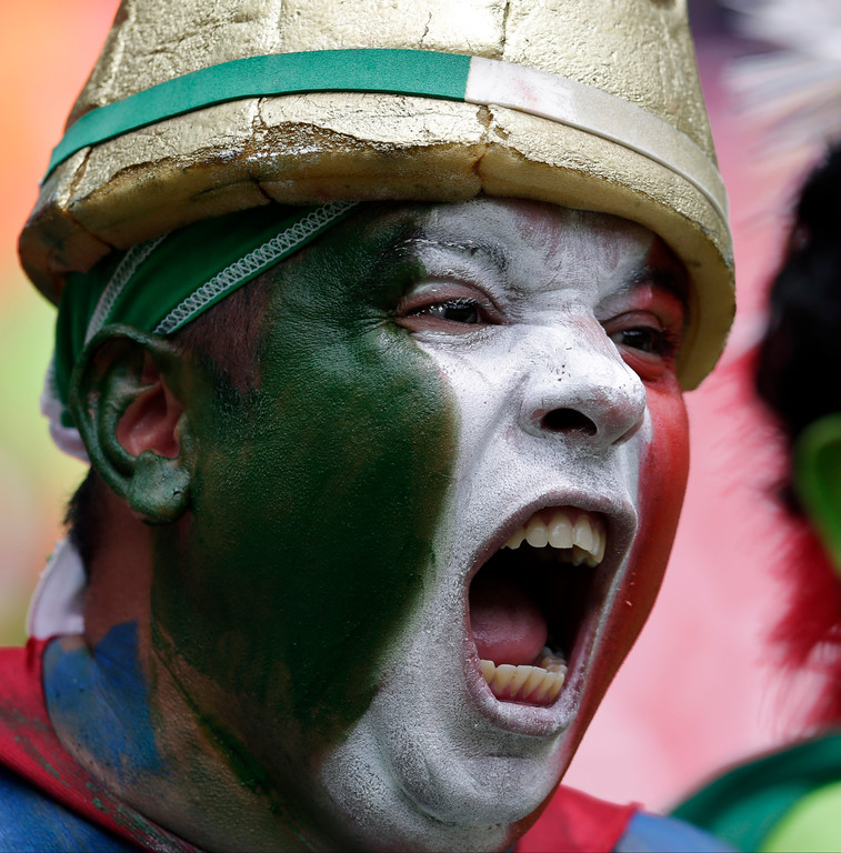 . An Italian national team supporter yells before the group D World Cup soccer match between Italy and Costa Rica at the Arena Pernambuco in Recife, Brazil, Friday, June 20, 2014.  (AP Photo/Petr David Josek)
