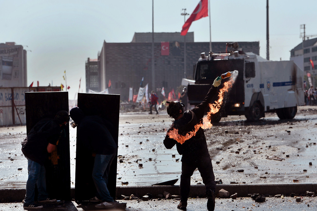 . A protester throws a Molotov cocktail durign clashes with riot police in istanbul\'s Taksim square on June 11, 2013.   AFP PHOTO / ARIS MESSINIS/AFP/Getty Images