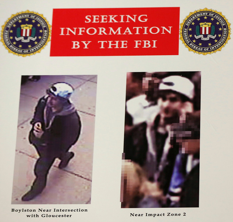 . Photos of a suspect in the Boston Marathon bombings are seen during a news conference in Boston, Massachusetts April 18, 2013. The FBI said on Thursday that it has identified two suspects in the Boston Marathon bombing and is asking the public for help in identifying the two men. REUTERS/Shannon Stapleton