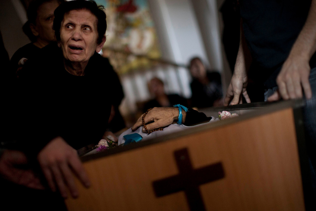. In this Nov. 20, 2012 photo, a Palestinian mourner cries during the funeral of Salem Paul Sweliem in Gaza City. This photo was one in a series of images by Associated Press photographer Bernat Armangue that won the first place prize in the World Press Photo 2013 photo contest for the Spot News series category.   (AP Photo/Bernat Armangue, File)