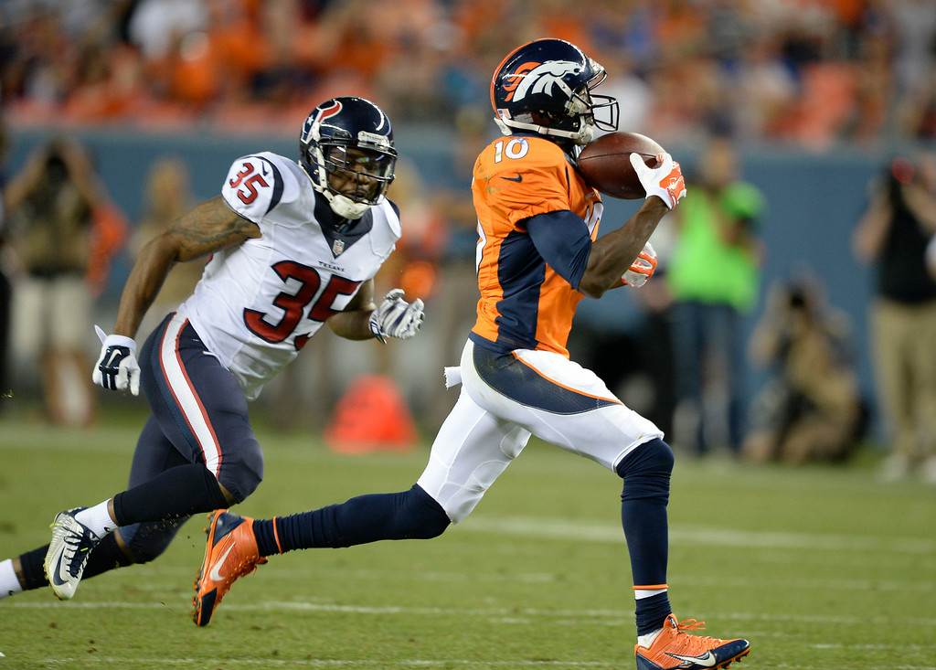 . DENVER, CO - AUGUST 23: Denver Broncos wide receiver Emmanuel Sanders (10) makes a one handed catch from Denver Broncos quarterback Peyton Manning (18) for a touchdown as Houston Texans defensive back Eddie Pleasant (35) gives chase during the second quarter August 23, 2014 at Sports Authority Field at Mile High Stadium. (Photo by John Leyba/The Denver Post)