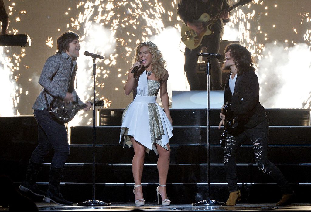 . NASHVILLE, TN - NOVEMBER 06:  The Band Perry performs onstage during the 47th annual CMA Awards at the Bridgestone Arena on November 6, 2013 in Nashville, Tennessee.  (Photo by Rick Diamond/Getty Images)