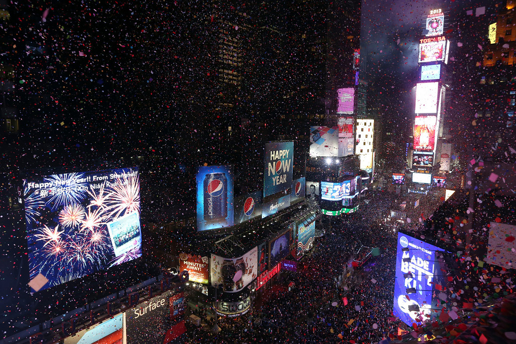 . Confetti flies over New York\'s Times Square after the clock strikes midnight during the New Year\'s Eve celebration as seen from the Marriott Marquis hotel Tuesday, Jan. 1, 2013 in New York.  (AP Photo/Mary Altaffer)