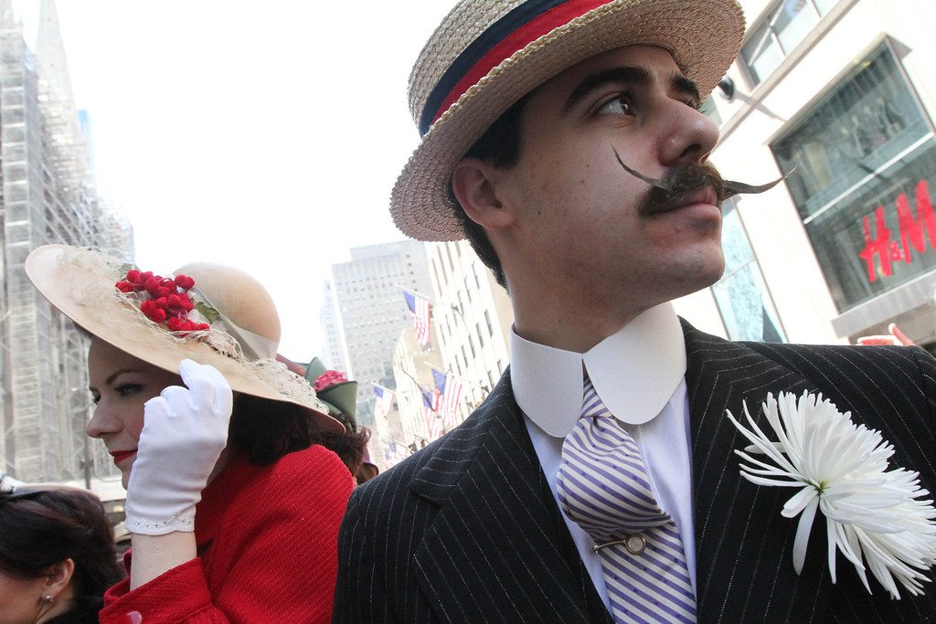 . Dressed for the occasion, Horst Rosenberg, right, takes part in the Easter Parade along New York\'s Fifth Avenue, Sunday, April 20, 2014. (AP Photo/Tina Fineberg)