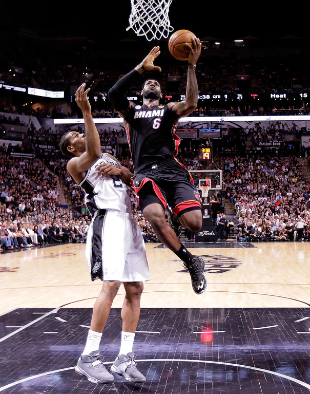 . LeBron James #6 of the Miami Heat goes up for a shot against Kawhi Leonard #2 of the San Antonio Spurs in the first half during Game Four of the 2013 NBA Finals at the AT&T Center on June 13, 2013 in San Antonio, Texas.  (Photo by Eric Gay/Pool/Getty Images)