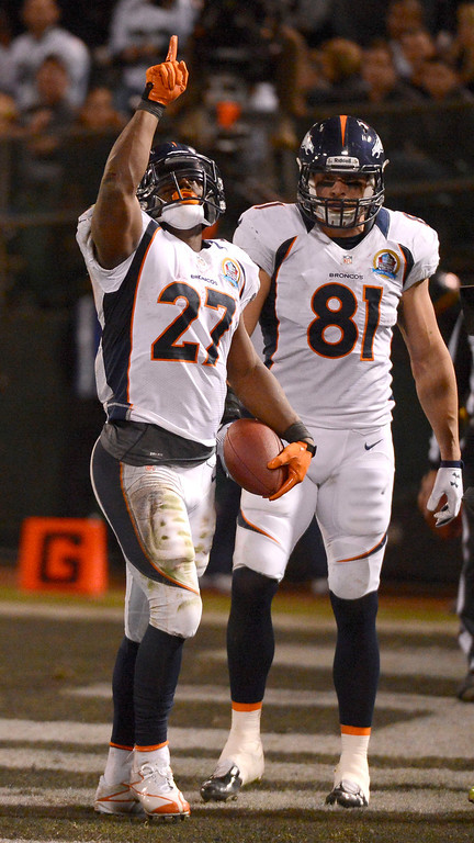 . Denver Broncos running back Knowshon Moreno (27) points to the sky after scoring a touchdown in the third quarter against the Oakland Raiders Thursday, December 6, 2012 during Thursday Night Football at O.c Coliseum in Oakland  John Leyba, The Denver Post