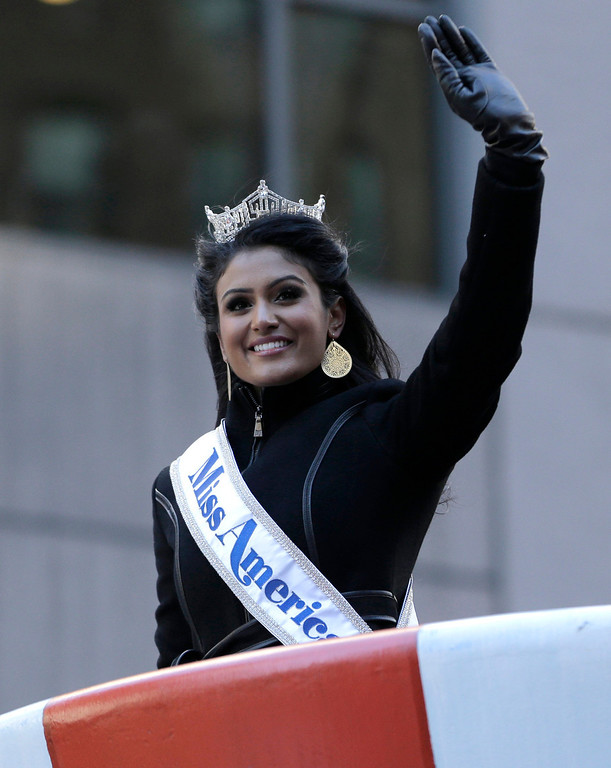 . Miss America Nina Davuluri waves at the crowd during the Macy\'s Thanksgiving Day Parade, Thursday, Nov. 28, 2013, in New York. (AP Photo/Julio Cortez)