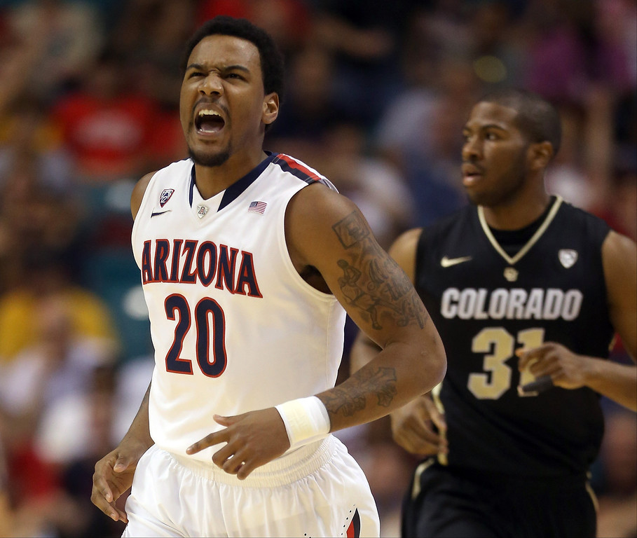 . Jordin Mayes #20 of the Arizona Wildcats reacts after making a three-pointer in the first half against the Colorado Buffaloes during the quarterfinals of the Pac-12 tournament at the MGM Grand Garden Arena on March 14, 2013 in Las Vegas, Nevada.  (Photo by Jeff Gross/Getty Images)