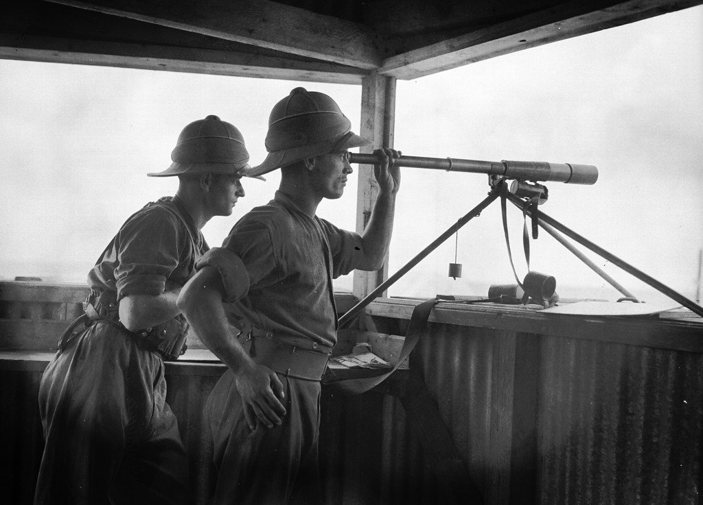 . November 1936:  Members of the 2nd Battalion of the former East Kent Regiment, informally known as Buffs, keep watch from a lookout post in Acre. The town was part of the British mandate of Palestine from 1918 until 1949, when it was incorporated into the state of Israel.  (Photo by Fox Photos/Getty Images)