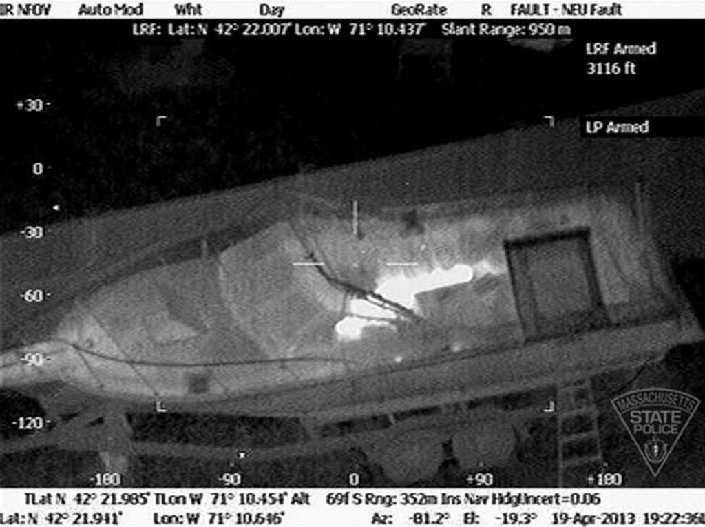 . This Friday, April 19, 2013 image made available by the Massachusetts State Police shows 19-year-old Boston Marathon bombing suspect, Dzhokhar Tsarnaev, hiding inside a boat during a search for him in Watertown, Mass. He was pulled, wounded and bloody, from the boat parked in the backyard of a home in the Greater Boston area. (AP Photo/Massachusetts State Police)
