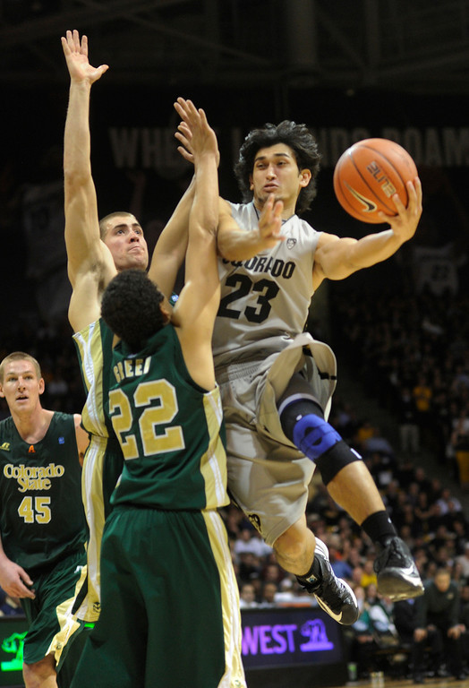. Buffs guard Sabatino Chen (23) curled around FAms defender Dorian Green (22) in the second half. The University of Colorado men\'s basketball team defeated Colorado State University 70-61 at the Coors Events Center Wednesday night, November 5, 2012. Karl Gehring/The Denver Post