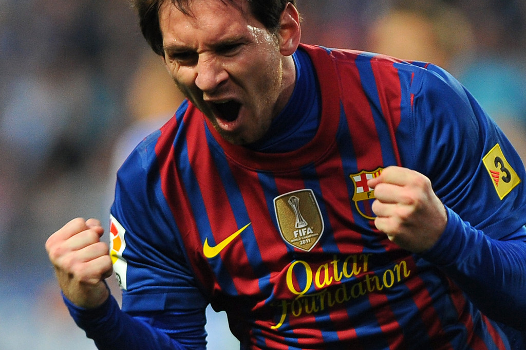 . Barcelona\'s Argentinian forward Lionel Messi celebrates after scoring during the Spanish league football match Malaga CF vs FC Barcelona on January 22, 2012 at Rosaleda stadium in Malaga.   Jorge Guerrero/AFP/Getty Images