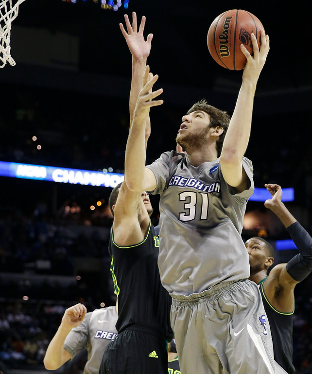 . Creighton center Will Artino shoots against Baylor during the first half of a third-round game in the NCAA college basketball tournament Sunday, March 23, 2014, in San Antonio. (AP Photo/David J. Phillip)