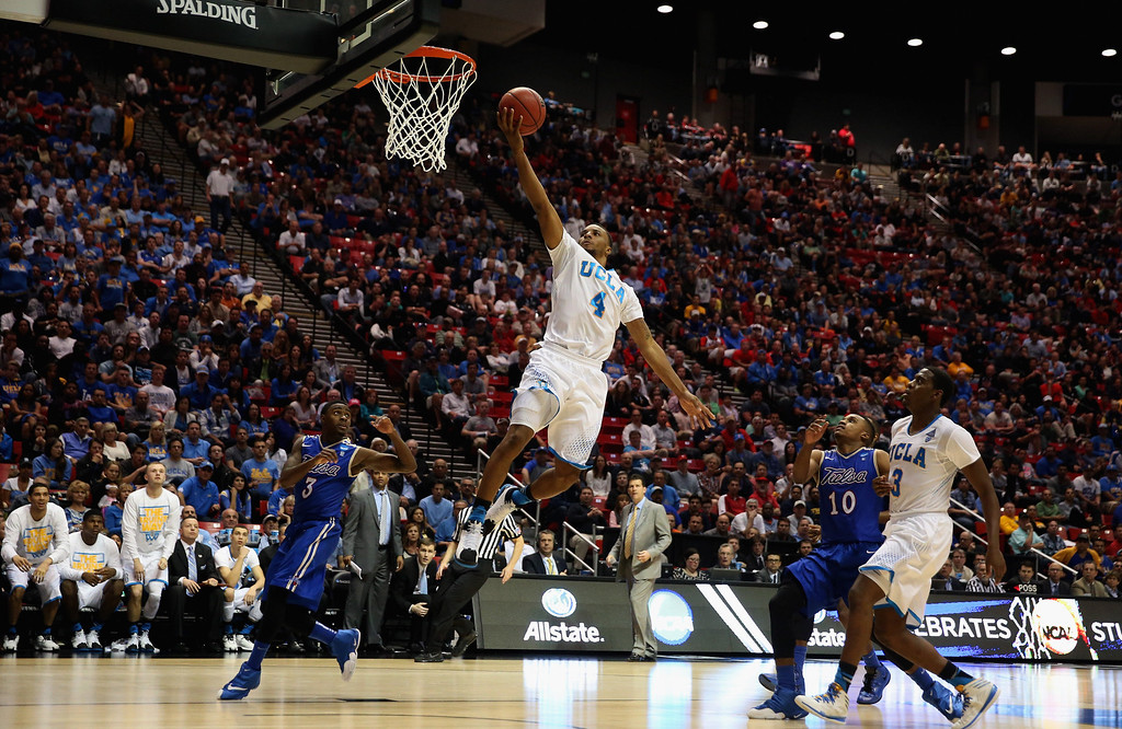 . Norman Powell #4 of the UCLA Bruins lays up a shot against the Tulsa Golden Hurricane during the second round of the 2014 NCAA Men\'s Basketball Tournament at Viejas Arena on March 21, 2014 in San Diego, California.  (Photo by Jeff Gross/Getty Images)