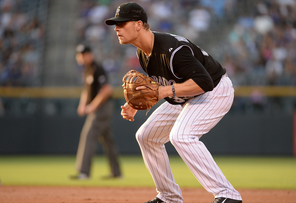 . Colorado Rockies first baseman Justin Morneau (33) gets ready during the second inning against the San Diego Padres July 8, 2014 at Coors Field. (Photo by John Leyba/The Denver Post)