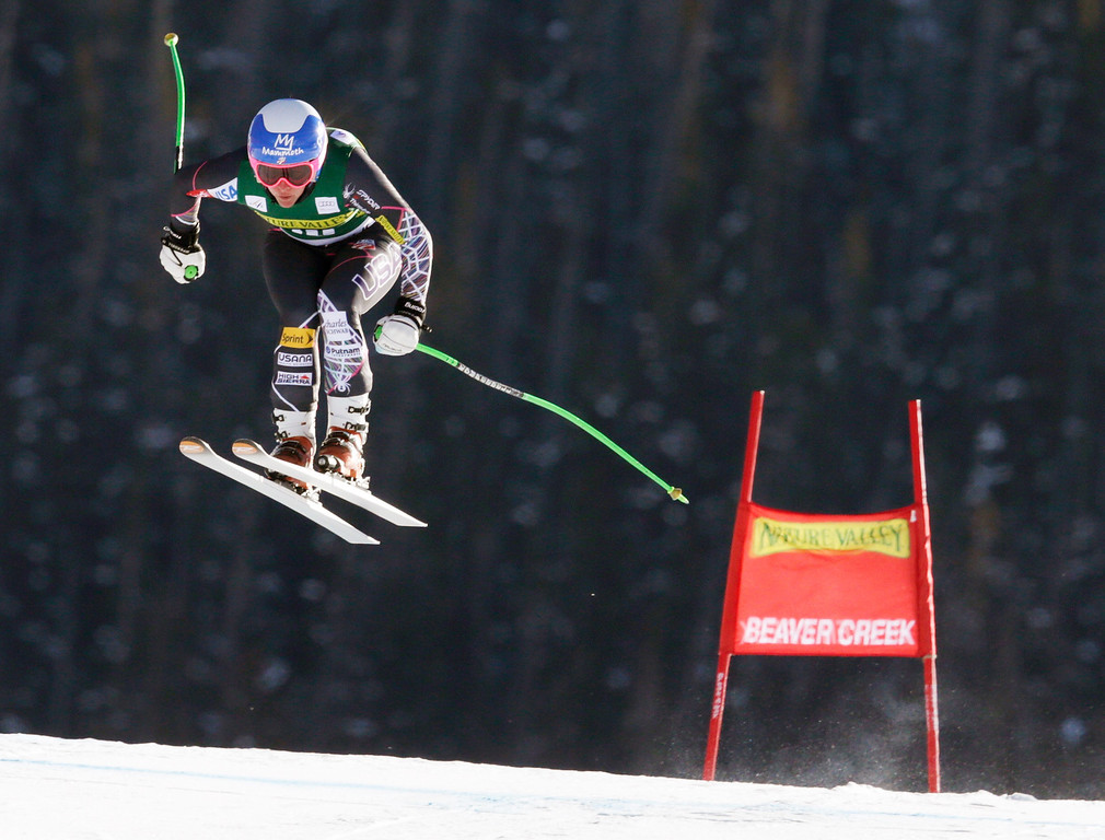 . Stacey Cook flies off the last jump during the women\'s World Cup Downhill skiing event, Friday, Nov. 29, 2013, in Beaver Creek, Colo. (AP Photo/Charles Krupa)