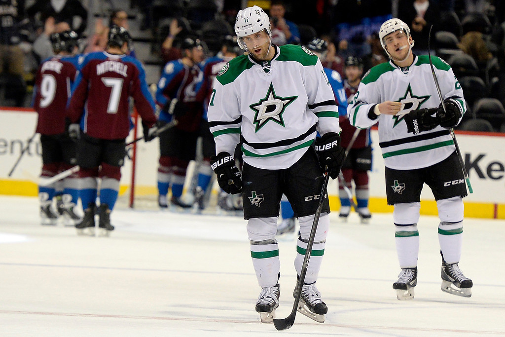 . DENVER, CO - DECEMBER 16: Dallas Stars center Rich Peverley (17) and center Colton Sceviour (22) skate off the ice as the Colorado Avalanche celebrate their 6-2 win. The Colorado Avalanche hosted the Dallas stars at the Pepsi Center. (Photo by AAron Ontiveroz/The Denver Post)