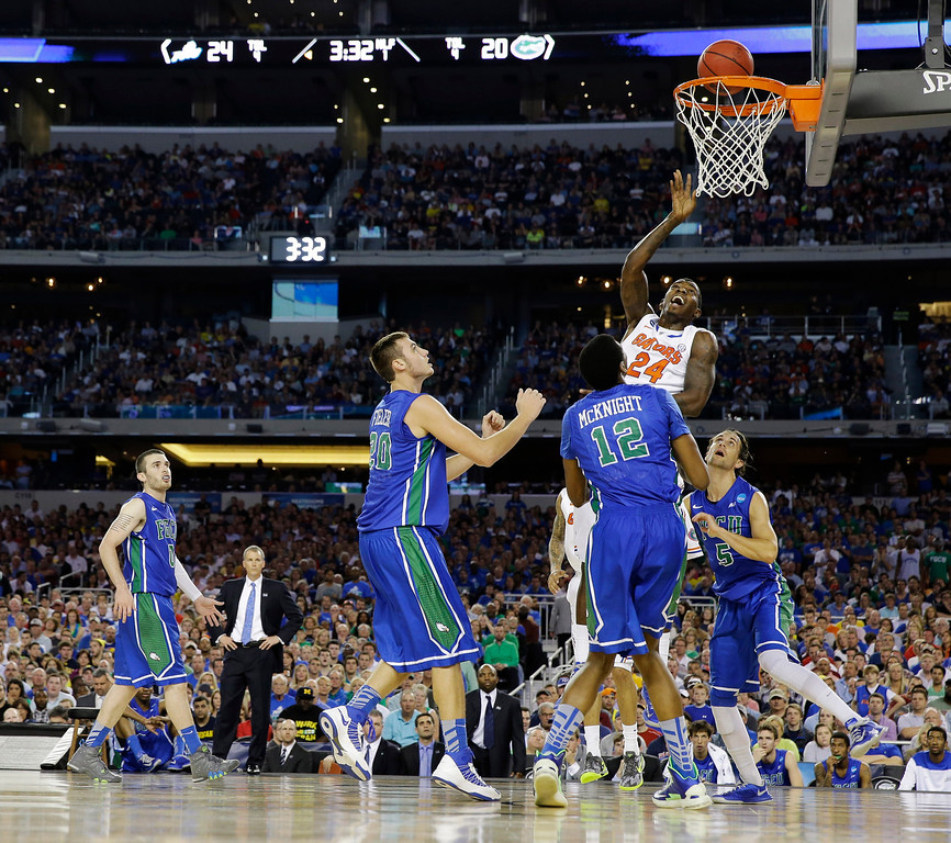 . Florida\'s Casey Prather (24) shoots in traffic during the first half of a regional semifinal game against Florida Gulf Coast in the NCAA college basketball tournament, Friday, March 29, 2013, in Arlington, Texas. (AP Photo/David J. Phillip)