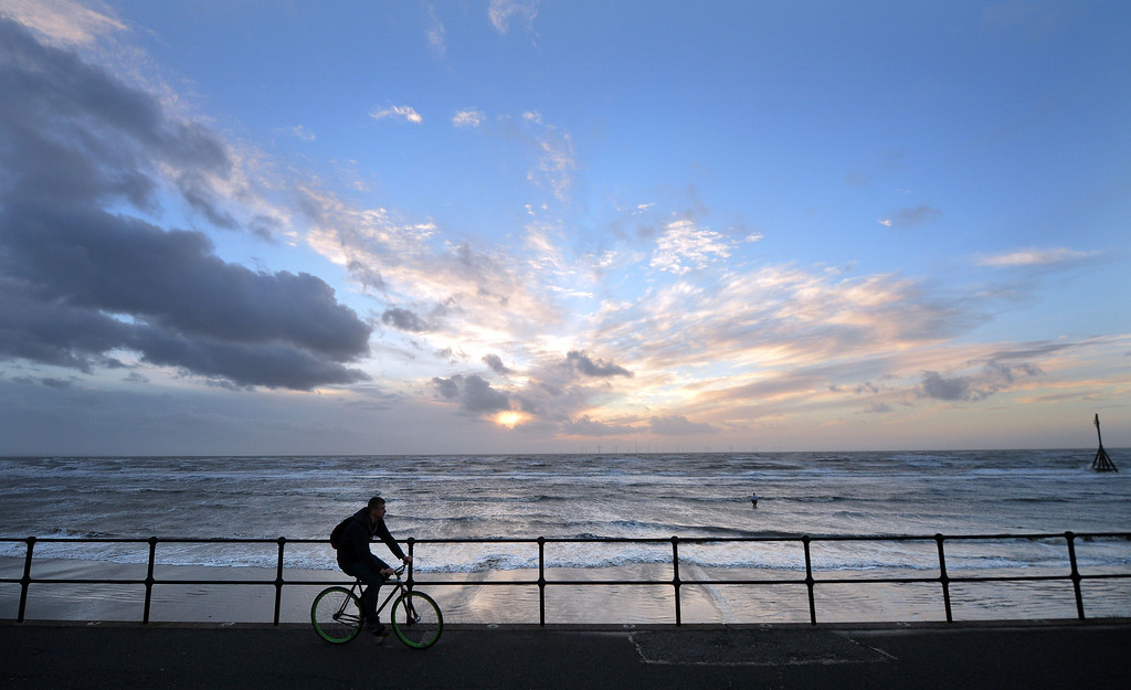 . A man cycles along the seafront near Crosby in north west England on October 27, 2013. Britain was braced for its worst storm in a decade, with heavy rain and winds of more than 80 miles (130 kilometres) an hour set to batter the south of the country.   PAUL ELLIS/AFP/Getty Images