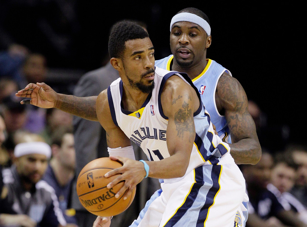 . Denver Nuggets\' Ty Lawson, right, defends Memphis Grizzlies\' Mike Conley during the first half of an NBA basketball game in Memphis, Tenn., Saturday, Dec. 28, 2013. (AP Photo/Danny Johnston)